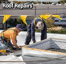 Roofers Repairing a Roof