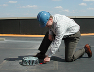 Man Providing Preventatitve Roof Maintenance